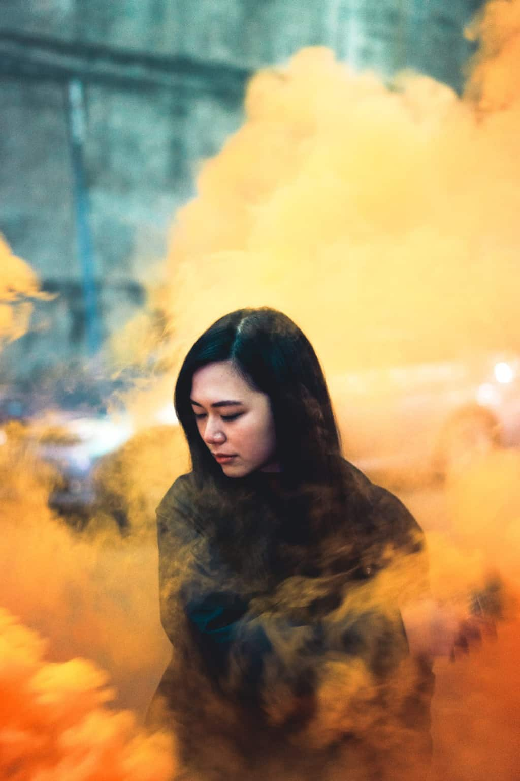 A Girl With Orange Baground Smoke