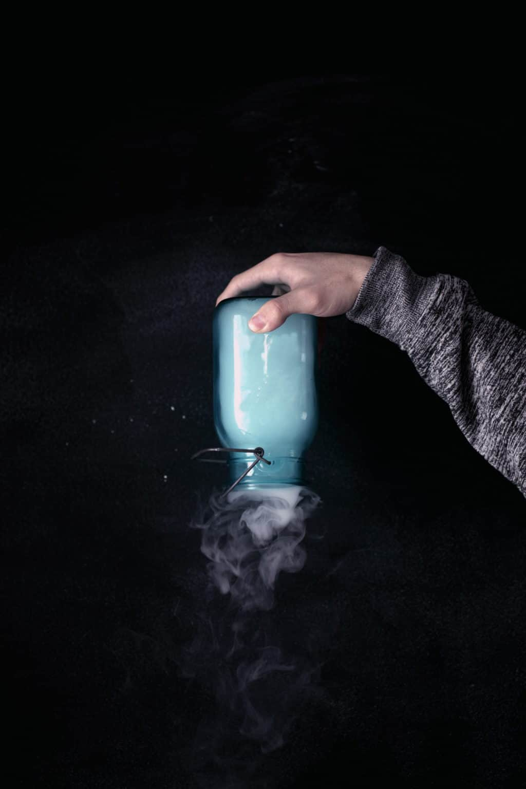 A Jar With Vape Smoke Holded Upside Down